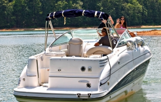 Photo of Three Happy People Using a Lake Winnipesaukee Boat Rental.